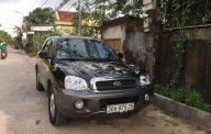 Cần bán xe Hyundai Santa Fe sản xuất năm 2004, màu đen, 265tr giá 265 triệu tại Nghệ An