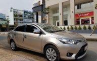 Cần bán xe Toyota Vios (1.5 E) CVT, sản xuất 2016, màu ghi-vàng, gia đình sử dụng mới 98% giá 495 triệu tại Tp.HCM