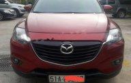 Bán xe Mazda CX9 màu đỏ đô, đời 2014, máy 3.7L, số tự động đi được 70.000km giá 1 tỷ 75 tr tại Tp.HCM