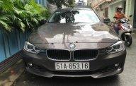 Cần bán BMW 3 Series 328i sản xuất năm 2013, màu nâu, xe nhập   giá 950 triệu tại Tp.HCM