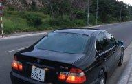 Bán xe BMW 3 Series 318i 2004, màu đen, nhập khẩu giá 260 triệu tại Tp.HCM
