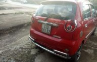 Cần bán Chevrolet Spark MT 2010, màu đỏ, đăng ký 2011 giá 115 triệu tại Bình Phước