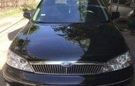 Bán Ford Laser năm 2003, màu đen số sàn, giá 165tr giá 165 triệu tại Tp.HCM