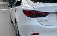Bán ô tô Mazda 6 2.0 AT sản xuất năm 2015, màu trắng chính chủ giá 729 triệu tại Tp.HCM