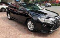 Cần bán xe Toyota Camry 2.0E năm 2016, màu đen giá 920 triệu tại Hà Nội