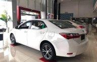 Cần bán Toyota Corolla Altis 1.8 E MT sản xuất 2018, màu trắng, xe mới 100% giá 697 triệu tại Tp.HCM