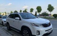 Gia đình bán Kia Sorento 2.2 AT 2016, màu trắng giá 840 triệu tại Hà Nội