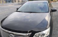 Chính chủ bán xe Toyota Camry 2.0E 2013, màu đen giá 775 triệu tại Hà Nội