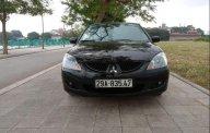 Bán lại xe Mitsubishi Lancer GLX1.6AT năm 2004, màu đen chính chủ giá 215 triệu tại Hà Nội