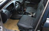 Cần bán xe Ford Laser 1.8 MT đời 2002, màu đen  giá 165 triệu tại Bắc Giang