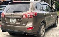 Bán xe Hyundai Santa Fe sản xuất 2011, màu nâu, xe nhập giá 710 triệu tại Bình Dương