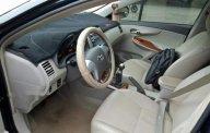 Cần bán lại xe Toyota Corolla Altis đời 2009, màu đen số sàn giá 387 triệu tại Tp.HCM