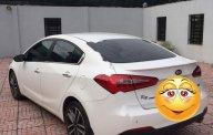 Bán Kia K3 2.0 AT đời 2015, màu trắng, xe gia đình giá 590 triệu tại Tp.HCM