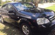 Cần bán Chevrolet Lacetti EX năm 2014, màu đen giá 285 triệu tại Tp.HCM