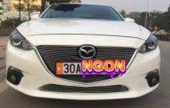 Bán ô tô Mazda 3 sản xuất 2015, màu trắng giá cạnh tranh giá 596 triệu tại Hà Nội