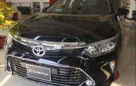 Cần bán Toyota Camry sản xuất 2019, màu đen giá 997 triệu tại Tp.HCM