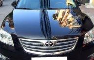 Bán Toyota Camry AT đời 2007, xe cũ màu đen giá 575 triệu tại Tp.HCM