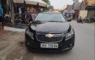 Chính chủ bán xe Cruze LS 2015 màu đen giá 350 triệu tại Thanh Hóa