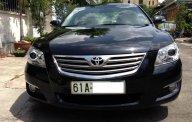 Cần bán xe Toyota Camry 2.4G đời 2008, màu đen giá 550 triệu tại Bình Dương