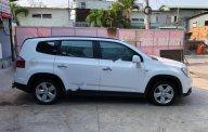Cần bán gấp Chevrolet Orlando đời 2012, màu trắng, xe gia đình  giá 399 triệu tại Tp.HCM