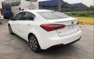 Cần bán Kia K3 2014, màu trắng giá 490 triệu tại Hà Nội