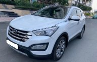 Cần bán lại xe Hyundai Santa Fe sản xuất năm 2014, màu trắng, nhập khẩu nguyên chiếc  giá 839 triệu tại Tp.HCM