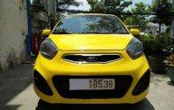 Bán xe Kia Morning 1.25MT sản xuất năm 2014, màu vàng số sàn giá 238 triệu tại Tp.HCM