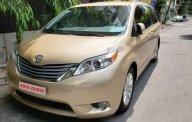 Bán ô tô Toyota Sienna năm 2010, màu vàng, nhập khẩu nguyên chiếc giá 1 tỷ 290 tr tại Tp.HCM