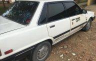 Cần bán Toyota Camry Le sản xuất năm 1986, màu trắng, nhập khẩu nguyên chiếc giá 60 triệu tại Tiền Giang