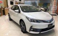 Bán ô tô Toyota Corolla Altis 1.8G CVT sản xuất năm 2019, màu trắng giá 761 triệu tại Tp.HCM
