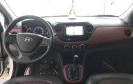 Bán Hyundai Grand i10 1.2AT sedan, màu trắng, số tự động, sản xuất 2018, đi 8000km giá 418 triệu tại Tp.HCM