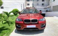 Bán BMV X6 3.0 sx 2012 đăng ký 2013, xe đẹp màu đỏ, bao kiểm tra hãng giá 1 tỷ 460 tr tại Tp.HCM