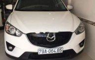 Mình cần bán Mazda CX5 đời 2014 màu trắng, số tự động giá 679 triệu tại Tp.HCM