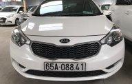 Bán Kia K3 1.6MT màu trắng, số sàn, sản xuất 2014, Đk 2015 một chủ đi 68000km giá 448 triệu tại Tp.HCM