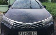 Bán Toyota Corolla altis 1.8MT 2014, màu đen, chính chủ giá 520 triệu tại Tp.HCM