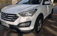 Cần bán Hyundai Santa Fe 2.2 máy dầu, màu trắng Sx 2015, xe tư nhân chính chủ giá 830 triệu tại Hà Nội