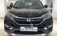 Bán xe Honda CR V 2.4, AT sản xuất cuối 2015, bản full opition, màu đen, xe còn rất mới, rất đẹp giá 865 triệu tại Tp.HCM
