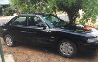Cần bán xe Mazda 626 LX năm sản xuất 1997, màu đen giá 80 triệu tại Bình Định