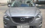 Bán Mazda CX 5 2.0AT đời 2014, màu bạc, xe gia đình giá 650 triệu tại Tp.HCM