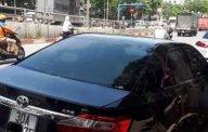 Bán xe Toyota Camry 2.0 đời 2013, màu đen, đăng ký tháng 12/2013 giá 825 triệu tại Hà Nội