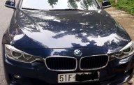 Bán BMW 320i sản xuất 2015, màu xanh đen, đi 36.000km, chính chủ bán giá 950 triệu tại Tp.HCM