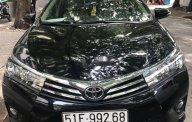 Cần bán xe Toyota Corolla altis 1.8 đời 2015, màu đen, nhập khẩu, xe nguyên bản giá 650 triệu tại Tp.HCM