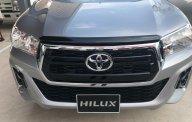 Bán Toyota Hilux 2.4 số sàn đời 2019, màu bạc, nhập khẩu nguyên chiếc giá 622 triệu tại Tp.HCM