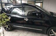 Cần bán Kia Carens đời 2010, màu đen còn mới giá 380 triệu tại Bình Dương