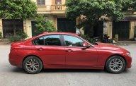 Chính chủ cần bán BMW 3 Series 320i đời 2012, màu đỏ, xe nhập liên hệ - 0989883329 giá 800 triệu tại Hà Nội