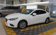 Bán ô tô Mazda 3 1.5AT, hỗ trợ trả góp 70% đời 2016, màu trắng giá 558 triệu tại Tp.HCM