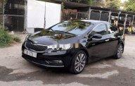 Cần bán Kia K3 năm sản xuất 2014, màu đen giá 415 triệu tại Khánh Hòa
