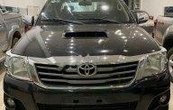Cần bán xe Toyota Hilux đời 2014, màu đen, nhập khẩu, chính hãng giá 425 triệu tại Gia Lai