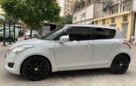 Bán Suzuki Swift 1.4 AT 2014, màu trắng giá cạnh tranh giá 373 triệu tại Hà Nội