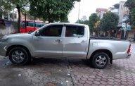 Cần bán lại xe Toyota Hilux sản xuất 2012, màu bạc giá 335 triệu tại Hà Nội